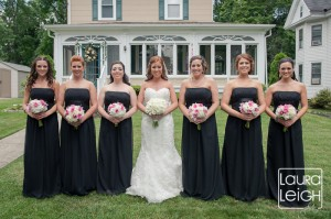 Alison's bridesmaids carried bouquets of white hydrangea, pink roses and pink cymbidium orchids.  They really popped against the black dresses!